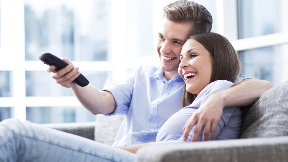 TV watching couple-iStock_000025629602_medium