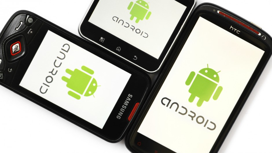 Bucharest, Romania - April 29, 2012: Close-up shot of three Android smartphones, Samsung Galaxy S, Motorola Flipout and HTC Sensation XE, with the Android logo displayed on the screen. Android is a software stack for mobile devices that includes an operating system, middle-ware and key applications.