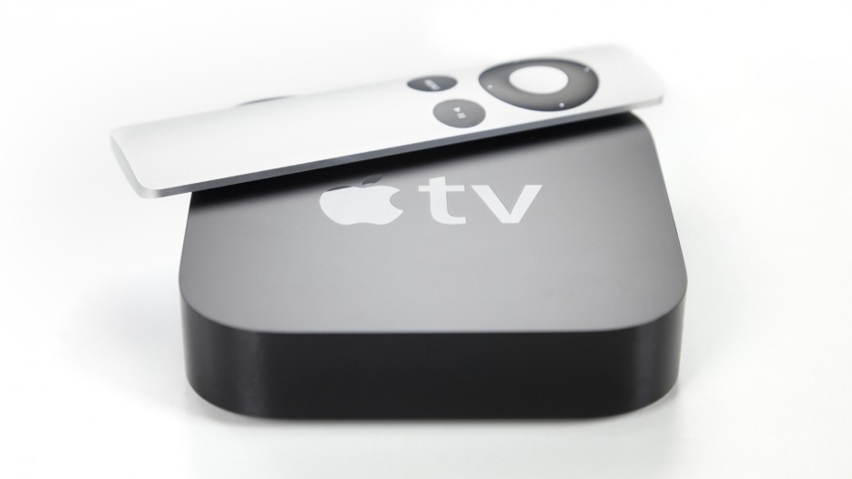 View of a second generation Apple TV and remote control, white background