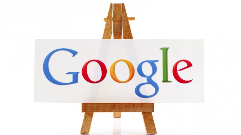 Tambov, Russian Federation - January 22, 2015 Wooden easel paper with word Google on it. White background. Word Google out of focus. Studio shot.