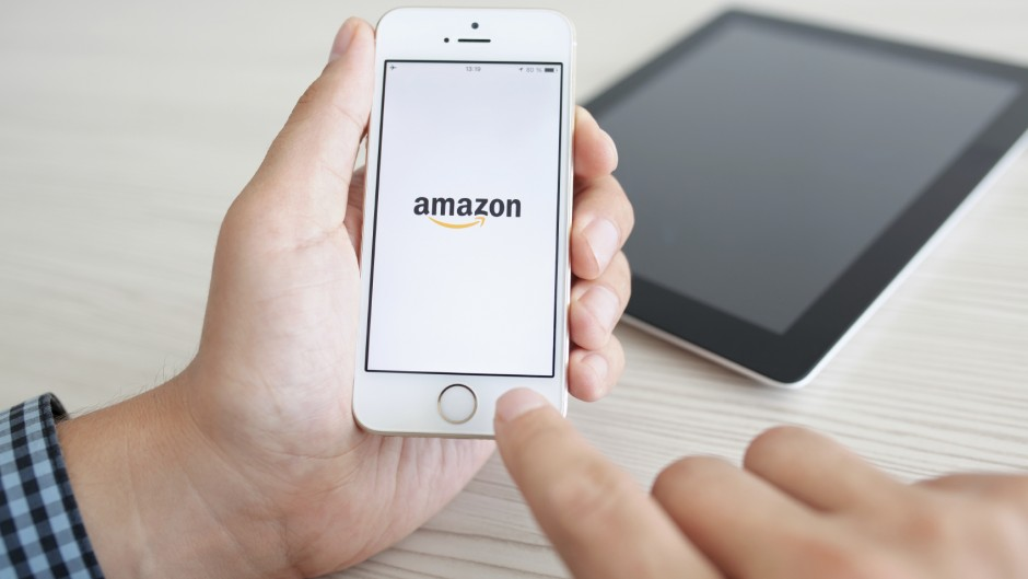 Simferopol, Russia - July 14, 2014: Amazon the American company selling goods and services on the Internet worldwide.