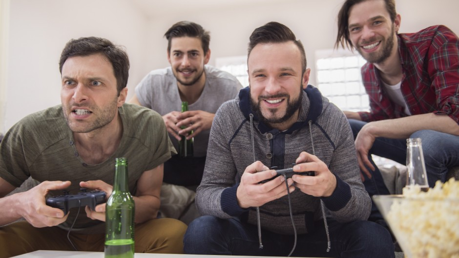 gaming and watching - iStock_000065379453_Medium