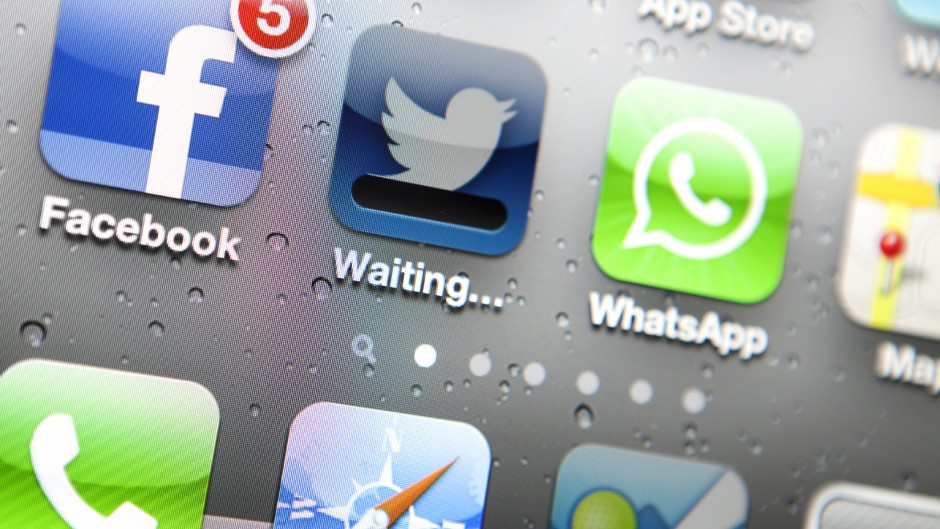 Apple Iphone screen with social media applications of Facebook, Twitter, Foursquare, map,banjo and Whatsapp. ---- An Apple Iphone screen showing social media applications including Facebook, Twitter, Foursquare, safari,map,banjo  and Whatsapp.