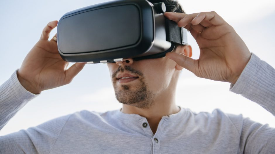 Young Man Using Virtual Glasses