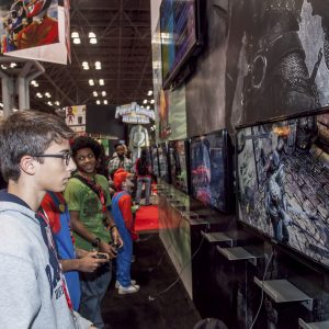 "NEW YORK - October 13: Fans try new game  ""Dark SoulsII II"" during Comic Con 2013 at The Jacob K. Javits Convention Center on October 13, 2013 in New York City."