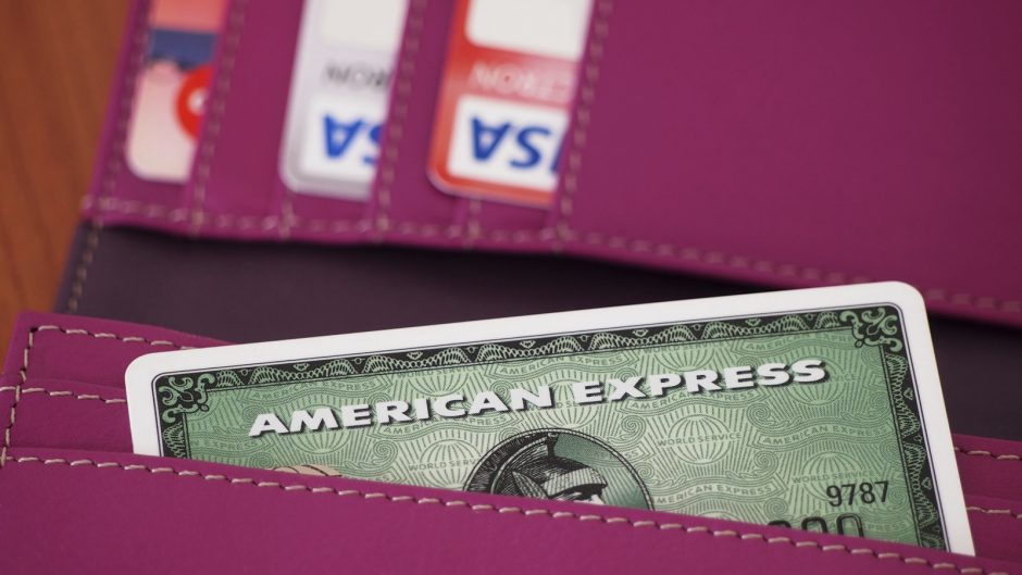 Zagreb, Croatia - January 25, 2014: Photo of green American express card in wallet and Visa cards in background. American express is one of most popular credit cards worldwide.
