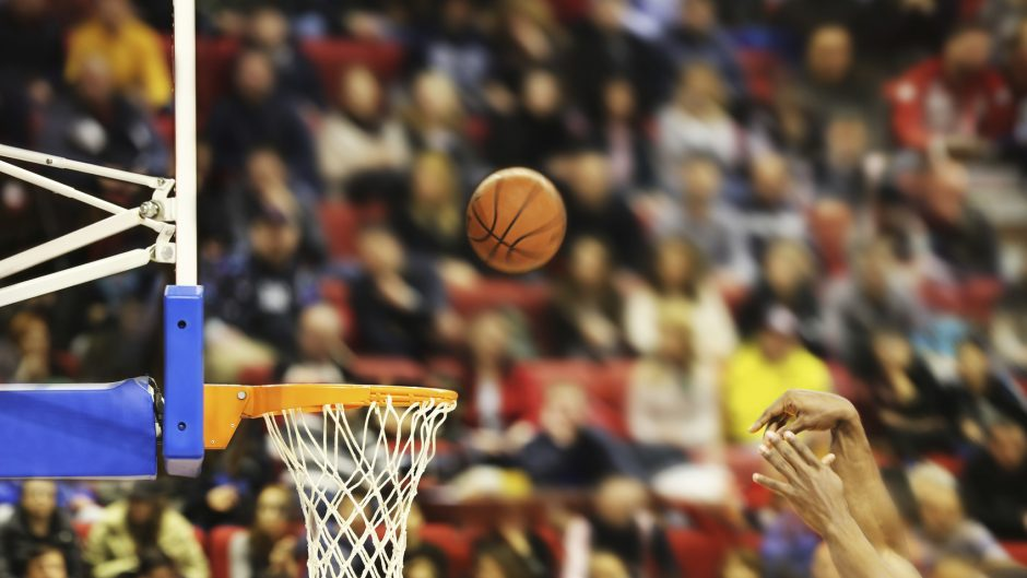 Scoring the winning points at a basketball game , motion blur