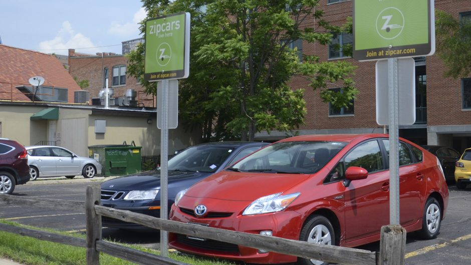 Ann Arbor, Michigan, United States - June 21, 2013: Zipcar, with cars available at locations such as the one shown here on June 21, 2013, was purchased by Avis in January 2013.