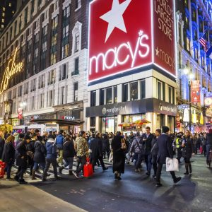 New York, NY, USA - December 21, 2015: A large crowd of shoppers and tourists in Herald Square near Macy's in New York City.