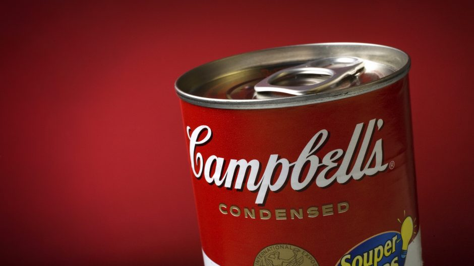 Brasilia, Brazil - August 30, 2008: Classic Campbell's Condensed Soup Can registered on a red background. Produced in 1962 by the american artist Andy Warhol, the art that illustrates the can became famous worldwide as a Pop Art Icon.