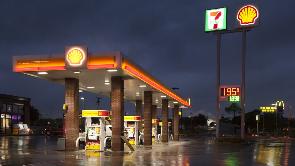 Dallas, USA - April 17, 2016: Shell gas station with a 7 eleven shop illuminated at night. Dallas, Texas, United States